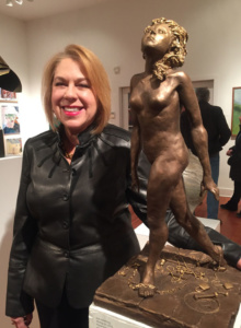The artist at The Woodstock Byrdcliffe Guild opening with her sculpture Moving On